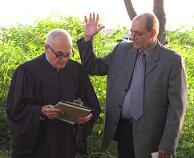 Justice Brown swears in new Village Trustee John Elefante.