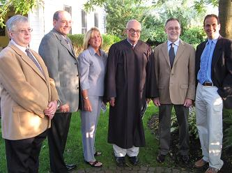 From left: Trustees Avrum Golub and John Elefante, Mayor Patricia Irving, Justice Charles Brown, and Trustees Peter Masterson and Joseph Affrunti
